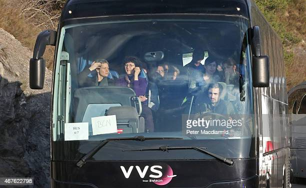 Coach believed to be carrying relatives of those who died onboard the crashed Germanwings flight arrives in Seyne on March 26, 2015 in France....
