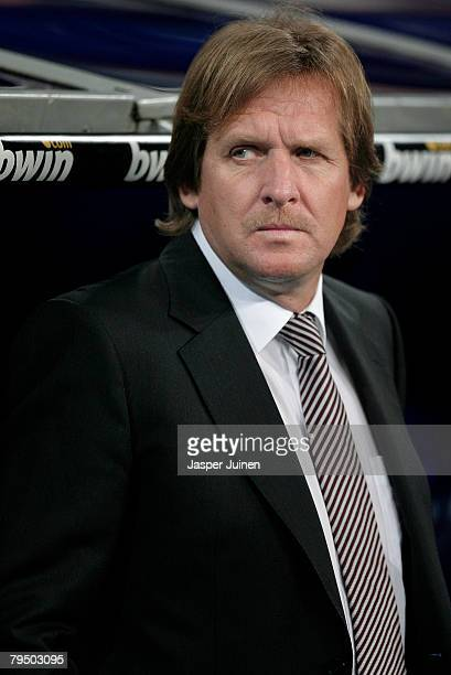 Coach Bernd Schuster of Real Madrid looks out of the dug out proir to the La Liga match between Real Madrid and Villarreal at the Santiago Bernabeu...