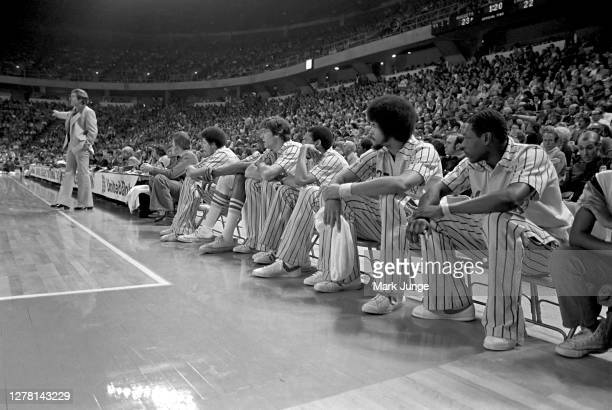 Coach Bill Fitch of the Cleveland Cavaliers coaches near the players' bench during a game against the Denver Nuggets at McNichols Arena on December 9...