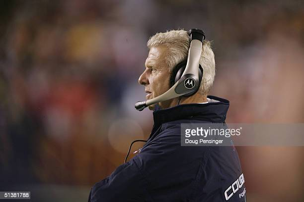 Coach Bill Parcells of the Dallas Cowboys watches the field during the game with the Washington Redskins at FedEx Field on September 27, 2004 in...