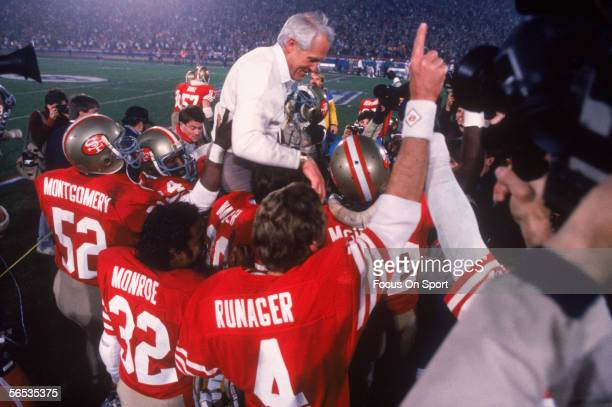 Coach Bill Walsh is held up by his San Francisco 49ers players after defeating the Cincinnati Bengals 2621 for Super Bowl XVI at the Pontiac...