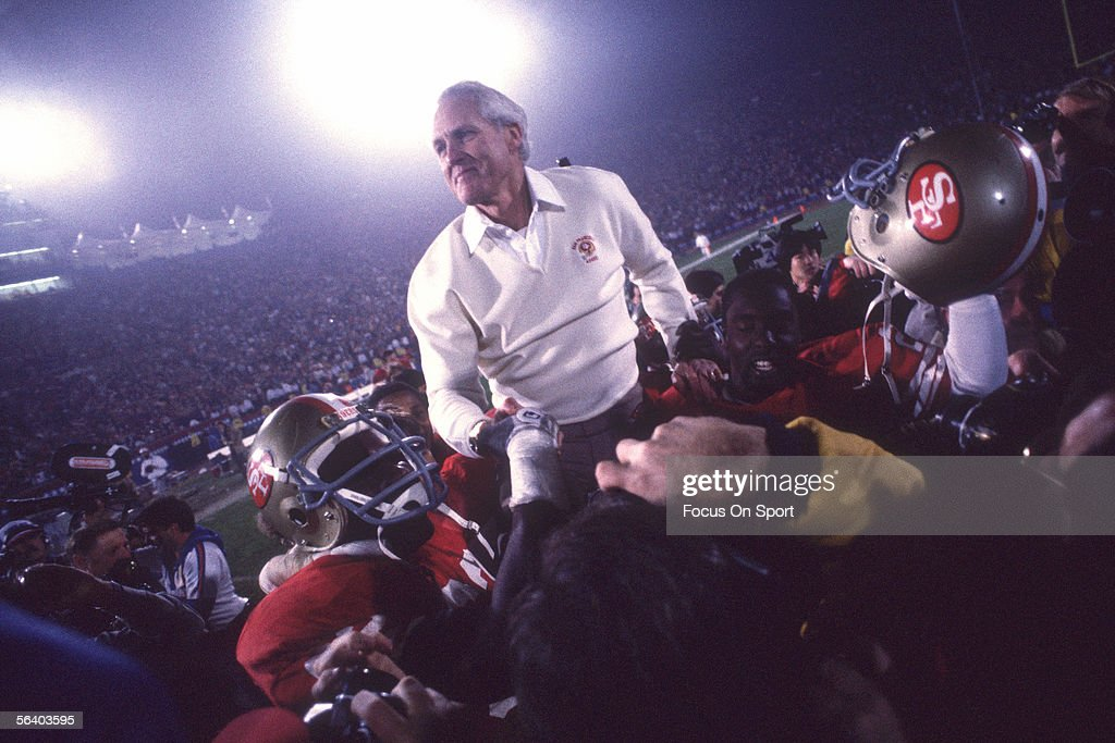 Coach Bill Walsh of the San Francisco 49er is carried on his team's shoulders after defeating the Miami Dolphins for Super Bowl XIX at Stanford Stadium on January 20, 1985 in Stanford, California. The San Francisco 49ers won 38-16.