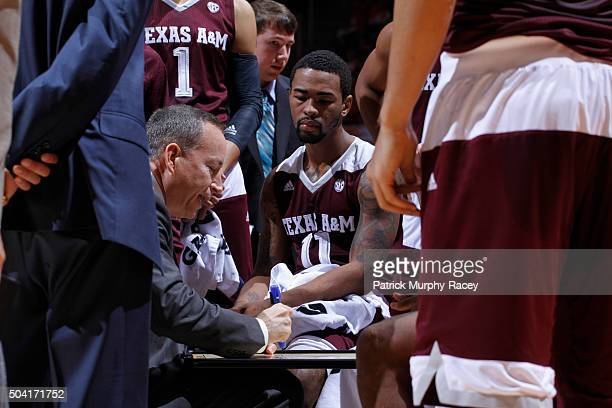 Coach Billy Kennedy of the Texas AM Aggies coaches in the huddle in a game at ThompsonBoling Arena on January 9 2016 in Knoxville Tennessee
