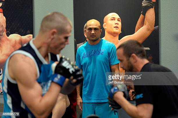 Coach BJ Penn coaches fighter Tim Williams as he warms up in the locker room before facing team Edgar fighter Dhiego Lima in their preliminary fight...