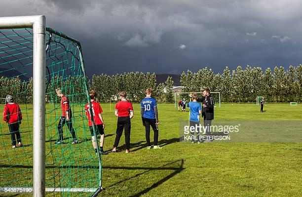 Coach Bjarki Mar Sverrisson trains 12/14 yearsold boys on June 28 2016 at the the football club Afturelding in Mosfellsbaer outside of Reykjavik...