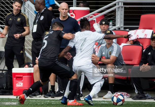 LAFC coach Bob Bradley watches a tussle between DC United midfielder Junior Moreno and Los Angeles FC forward Latif Blessing during a MLS match...