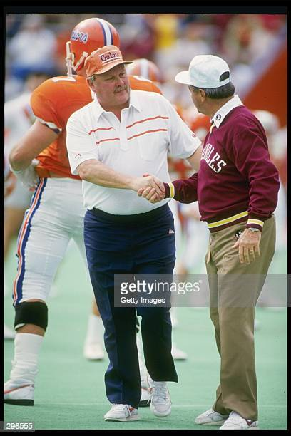 Coach Bobby Bowden of the Florida State Seminoles shakes hands with coach Galen Hall of the Florida Gators after a game at Florida Field in...