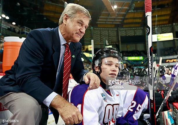 Coach Bobby Orr stands behind Mikhail Sergachev of Team Orr as they look on from the bench during the CHL/NHL Top Prospects Game January 28 2016 at...