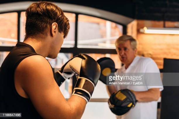 coach boxing with boxer in  ring - punching stock pictures, royalty-free photos & images