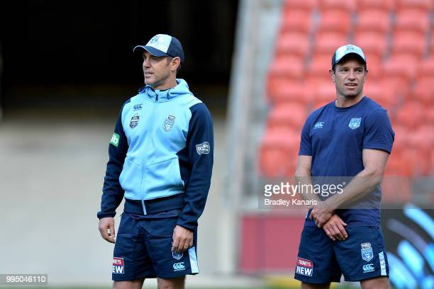 Coach Brad Fittler and Danny Buderus watch on during the New South Wales Blues State of Origin Captain's Run at Suncorp Stadium on July 10 2018 in...