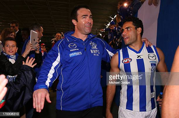 Coach Brad Scott and Daniel Wells of the Roos celebrate the win during the round 19 AFL match between the North Melbourne Kangaroos and the Geelong...
