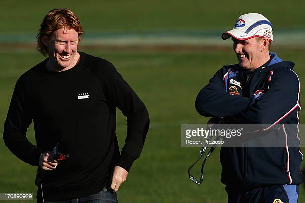 Coach Brendan McCartney and former AFL player Cameron Ling look on during a Western Bulldogs AFL training session at Whitten Oval on June 20 2013 in...