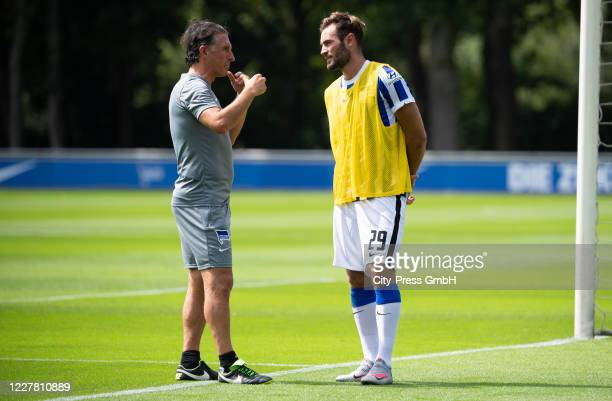 Coach Bruno Labbadia and Lucas Tousart of Hertha BSC chat after a training session on July 28, 2020 in Berlin, Germany.
