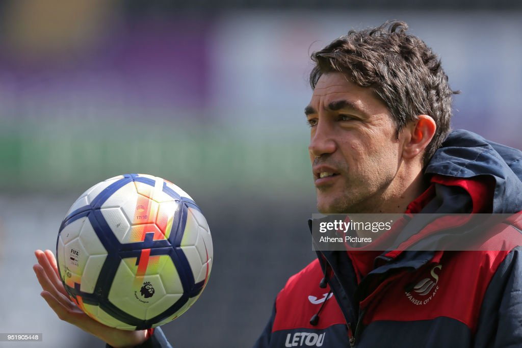 Coach Bruno Lage holds a football during the Swansea City Training at The Liberty Stadium on April 26, 2018 in Swansea, Wales.