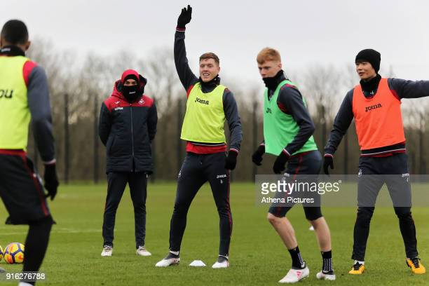 Coach Bruno Lage with players Alfie Mawson Sam Clucas and Ki SungYueng in action during the Swansea City Training and Press Conference at The...