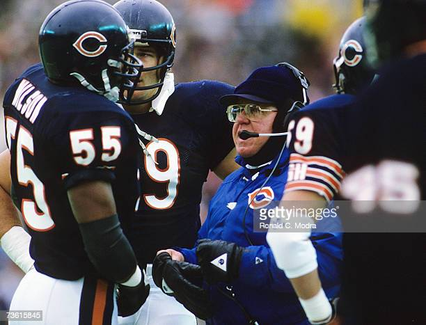 Coach Buddy Ryan of the Chicago Bears talking to Otis Wilson of the Chicago Bears during the NFC Championship Game against the Los Angeles Rams on...