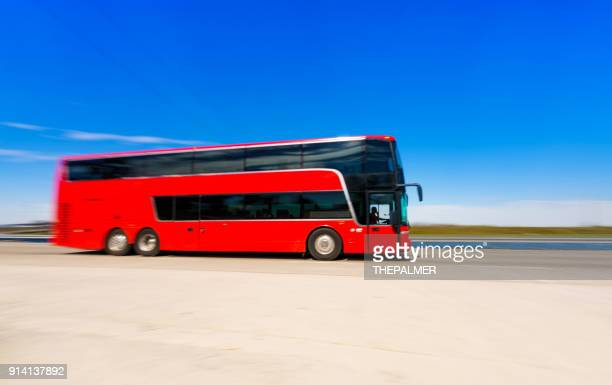 coach bus on the highway - coach bus stock photos and pictures