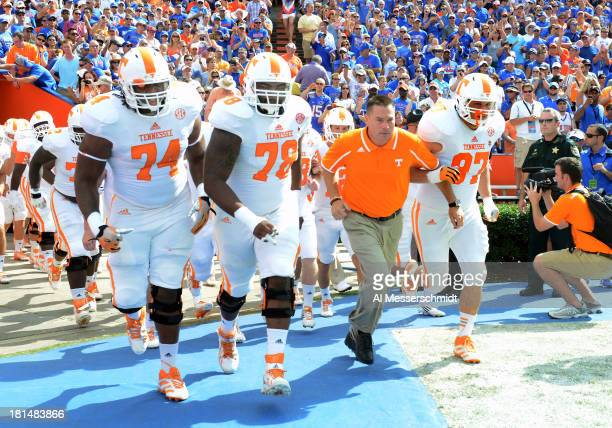 Coach Butch Jones of the Tennessee Volunteers leads the team to the field before play against the Florida Gators September 21 2013 at Ben Hill...