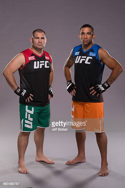 Coach Cain Velasquez and coach Fabricio Werdum pose for a portrait on media day during filming of The Ultimate Fighter Latin America on May 15, 2014...