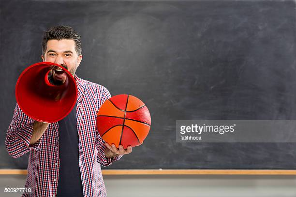 coach calling on blackboard. - march madness basketball stock photos and pictures