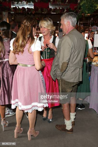 Coach Carlo Ancelotti and his wife Mariann Barrena McClay and Martina Rummenigge during the FC Bayern Wies'n as part of the Oktoberfest at...