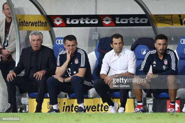Coach Carlo Ancelotti of Bayern Muenchen Willy Sagnol sporting director Hasan Salihamidzic of Bayern Muenchen and Davide Ancelotti during the...