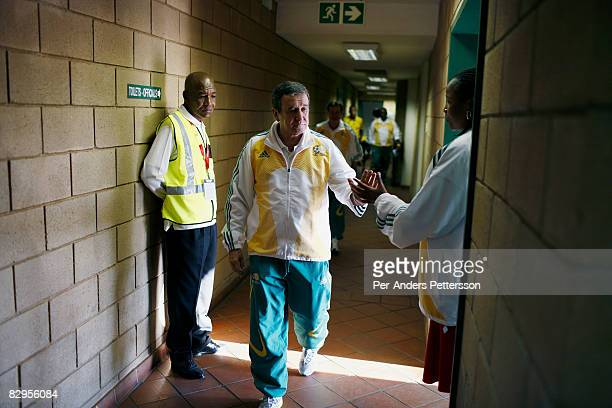 Coach Carlos Alberto Parreira walks out from the locker room as his team the South African national team plays badly during a friendly game against...