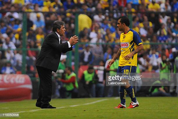 Coach Carlos Reinoso of America and Daniel Montenegro during their match as part of the 2011 Clausura Tournament at the Aztec Stadium on March 13...