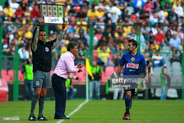 Coach Carlos Reinoso of America and players Vicente Sanchez during their match against Morelia as part of the Clausura 2011 at Azteca Stadium on...
