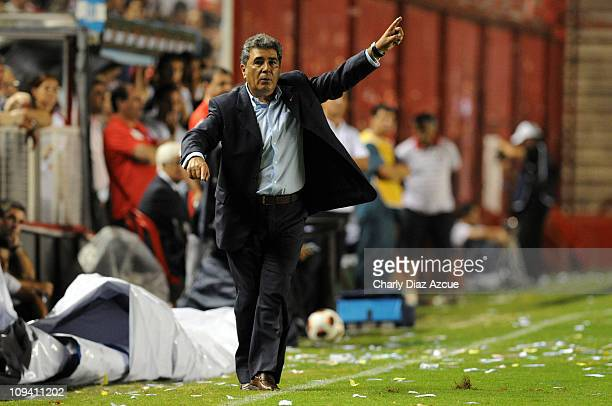 Coach Carlos Reinoso of America reacts during a match against Argentinos Juniors as part of the Copa Santander Libertadores 2011 at Diego Armando...