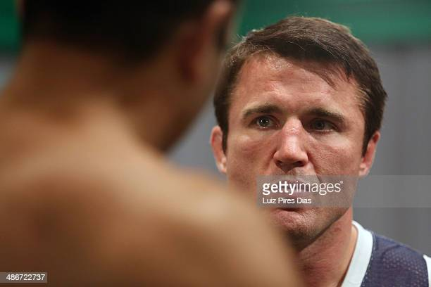 Coach Chael Sonnen speaks with Team Sonnen fighter Job Kleber after being defeated by Team Wanderlei fighter Richardson Moreira during season three...