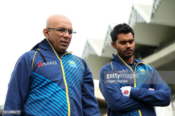Coach Chandika Hathurusingha and Dhananjaya De Silva of Sri Lanka look on during day five of the First Test match in the series between New Zealand...
