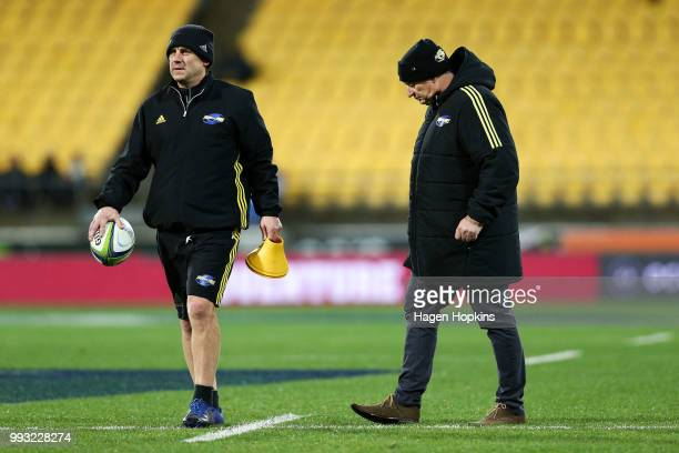 Coach Chris Boyd and assistant coach Jason Holland of the Hurricanes look on during the round 18 Super Rugby match between the Hurricanes and the...