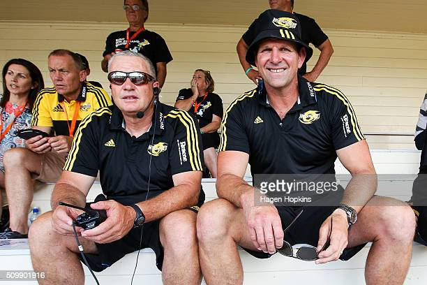 Coach Chris Boyd and assistant coach John Plumtree of the Hurricanes look on during the Super Rugby preseason match between the Blues and the...