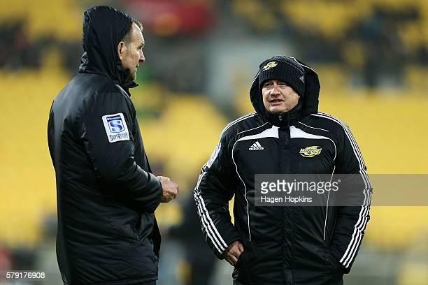 Coach Chris Boyd and assistant coach John Plumtree of the Hurricanes look on during the Super Rugby Quarterfinal match between the Hurricanes and the...