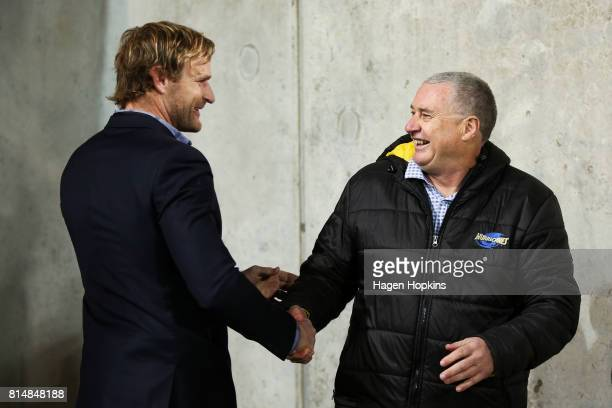 Coach Chris Boyd of the Hurricanes and coach Scott Robertson of the Crusaders wish each other well prior to the round 17 Super Rugby match between...
