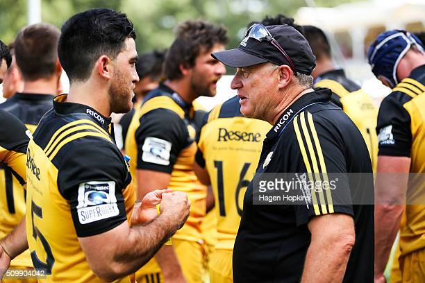 Coach Chris Boyd of the Hurricanes speaks to Nehe MilnerSkudder during the Super Rugby preseason match between the Blues and the Hurricanes at...
