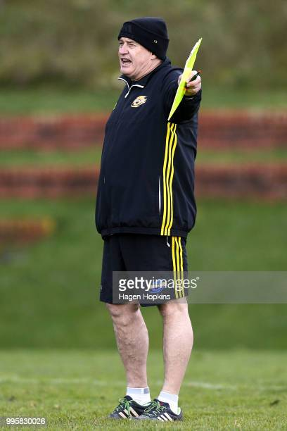 Coach Chris Boyd talks to his players during a Hurricanes Super Rugby training session at Rugby League Park on July 11 2018 in Wellington New Zealand