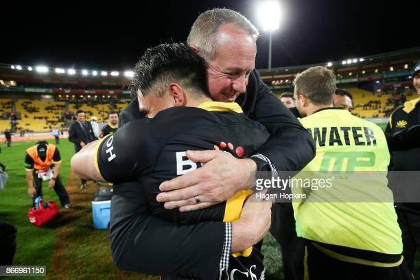 Coach Chris Gibbes of Wellington hugs Sheridan Rangihuna of Wellington after winning the Mitre 10 Cup Championship Final match between Wellington and...