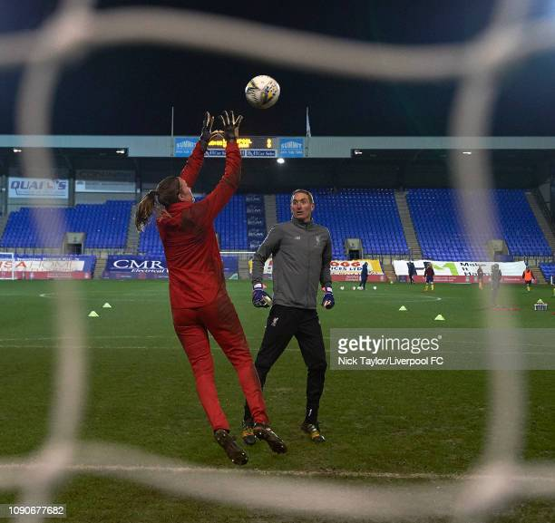 Coach Chris Kirkland and Anke Preuss of Liverpool Women in action during the warmup before the WSL game at Prenton Park on January 28 2019 in...