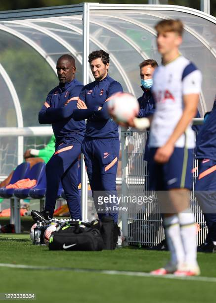 Coach Chris Powell with coach Ryan Mason of Spurs look on during the Premier League 2 match between Tottenham Hotspur and West Ham United at...