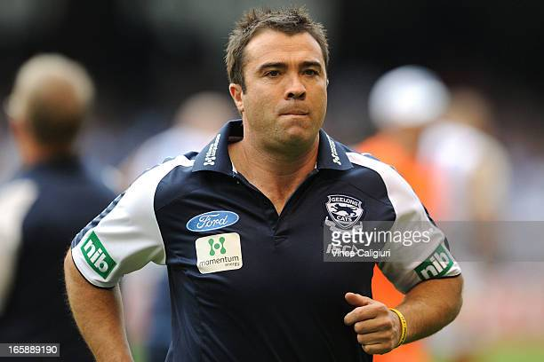 Coach Chris Scott of the Cats leaves the ground after 1/4 time during the round two AFL match between the Geelong Cats and the North Melbourne...