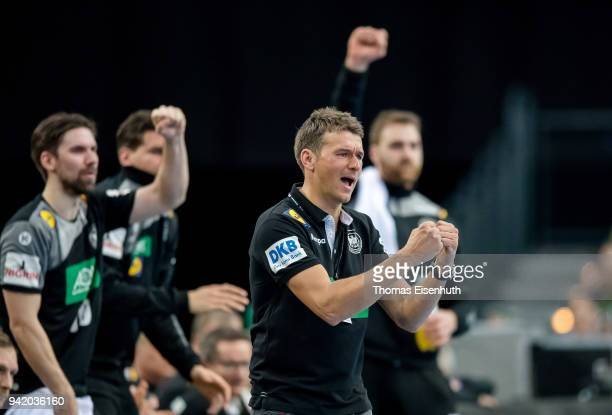 Coach Christian Prokop of Germany celebrates during the handball international friendly match between Germany and Serbia at Arena Leipzig on April 4...