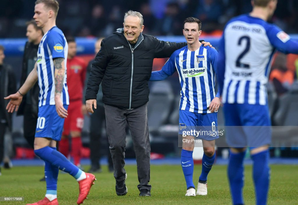 coach Christian Streich of SC Freiburg and Vladimir Darida of Hertha BSC after the Bundesliga match between Hertha BSC and SC Freiburg at Olympiastadion on March 10, 2018 in Berlin, Germany.