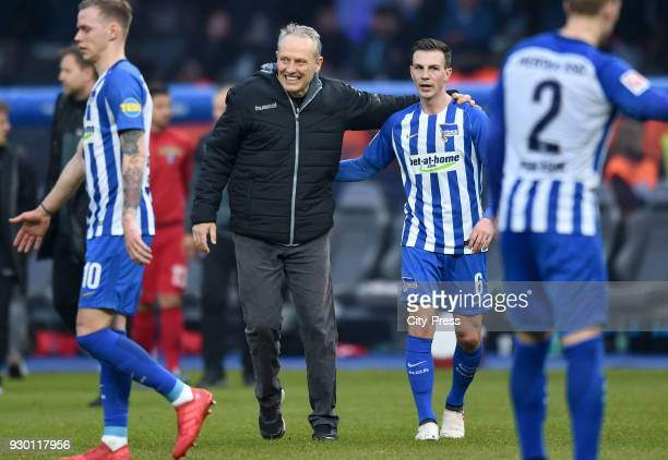 coach Christian Streich of SC Freiburg and Vladimir Darida of Hertha BSC after the Bundesliga match between Hertha BSC and SC Freiburg at...