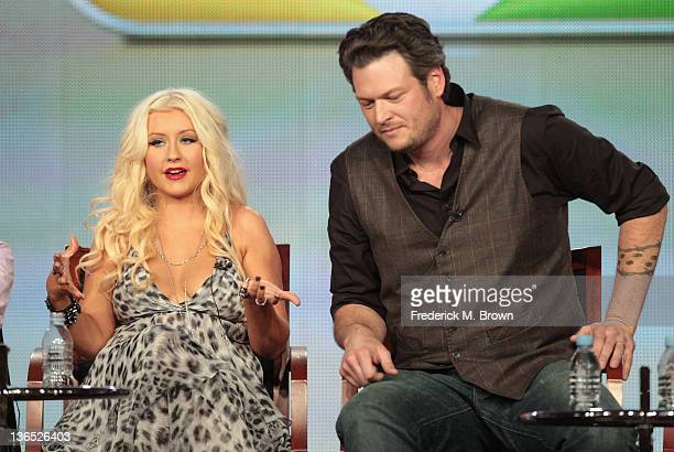 Coach Christina Aguilera and Coach Blake Shelton speak onstage during the The Voice panel during the NBCUniversal portion of the 2012 Winter TCA Tour...