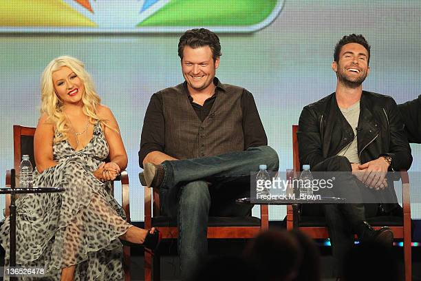 Coach Christina Aguilera Coach Blake Shelton and Coach Adam Levine speak onstage during the The Voice panel during the NBCUniversal portion of the...