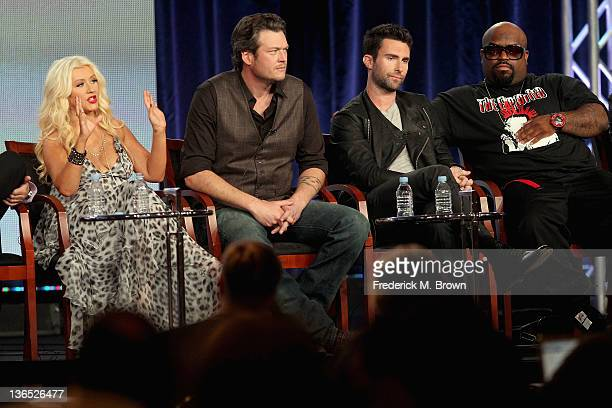 Coach Christina Aguilera Coach Blake Shelton Coach Adam Levine and Coach Cee Lo Green speak onstage during the The Voice panel during the...