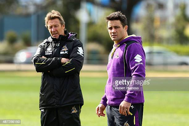 Coach Craig Bellamy and Cooper Cronk speak during a Melbourne Storm NRL training session at Gosch's Paddock on September 8, 2015 in Melbourne,...
