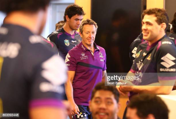 Coach Craig Bellamy arrives for the team photo during a Melbourne Storm NRL training session at Gosch's Paddock on September 25 2017 in Melbourne...